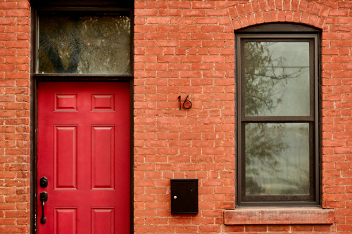 Red-door-on-brick-building